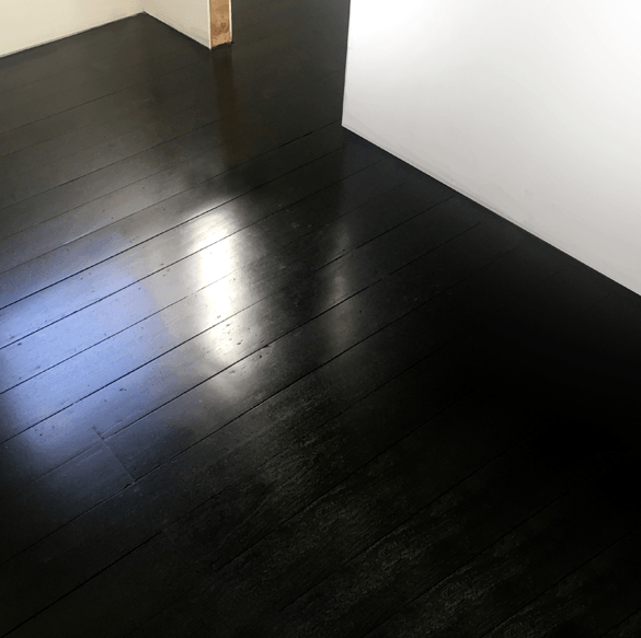 black stained jarrah floorboards